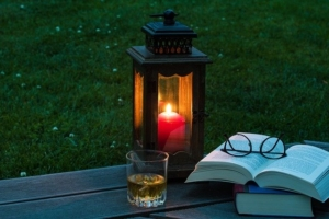 lantern on bench with book and glasses